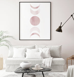 Black-Framed Moon Phases Watercolor Print in Bage and Brown on a living room wall