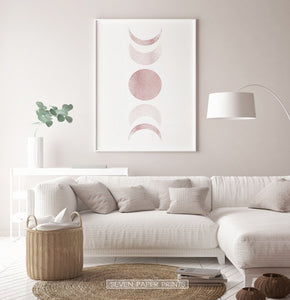 White-Framed Moon Phases Watercolor Print in Bage and Brown on a living room wall