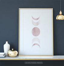 Load image into Gallery viewer, Golden-Framed Moon Phases Watercolor Print in Bage and Brown on a shelf