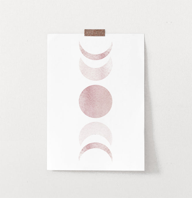 Frameless Moon Phases Watercolor Print in Bage and Brown on a wall