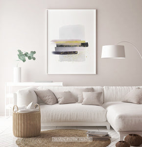 A framed poster with gray, yellow, and black horizontal smears on white background - in the living room 2