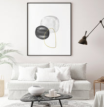 Load image into Gallery viewer, A black-framed wall art with black, silver and golden forms in a living room