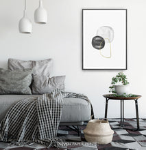 Load image into Gallery viewer, A black-framed wall art with black, silver and golden forms in a bedroom