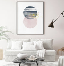 Load image into Gallery viewer, Black-framed Navy and pink Jupiter-like abstract wall art in a living room