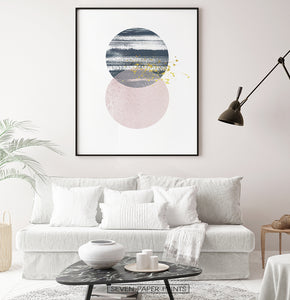 Black-framed Navy and pink Jupiter-like abstract wall art in a living room