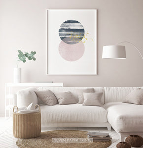 White-framed Navy and pink Jupiter-like abstract wall art in a living room