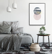 Load image into Gallery viewer, Black-framed Navy and pink Jupiter-like abstract wall art in a bedroom
