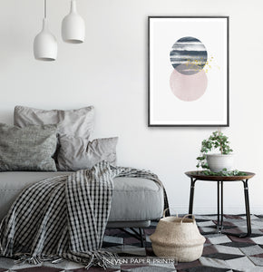 Black-framed Navy and pink Jupiter-like abstract wall art in a bedroom