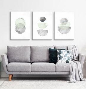Three Abstract Green and Gray Watercolor Art Prints above the sofa