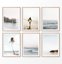 Load image into Gallery viewer, Coastal Wall Art Prints. Beach with palm trees and surfer. Ocean rock