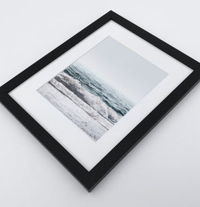 A white shore of the ocean photo in a black frame