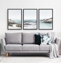 Load image into Gallery viewer, Three white shore of the ocean photos in frames above the sofa