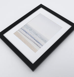 A framed photo print with ocean