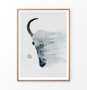 A smudged bull skull watercolor painting print in a frame