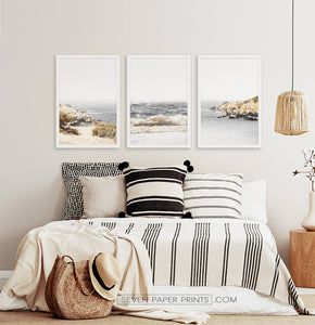 Three photo prints of sandy ocean shore in natural colors in black frames 2