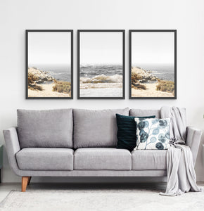 Three photo prints of sandy ocean shore in natural colors in black frames 3