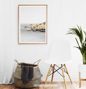 Gray Coastal Photography Hanging Above the Chair