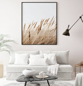 Brown reed field large wall art above white sofa