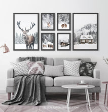 Load image into Gallery viewer, Reindeers, Sheep and Houses - Winter Black-Framed 6-Piece Set in the living room