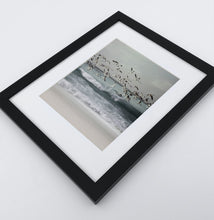 Load image into Gallery viewer, A framed print with seagulls flying above the ocean shore