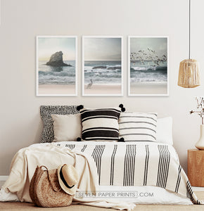 Three framed prints with a stormy ocean landscape 2