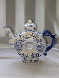 A circa mid 20th-century hand-painted blue and white teapot made in China