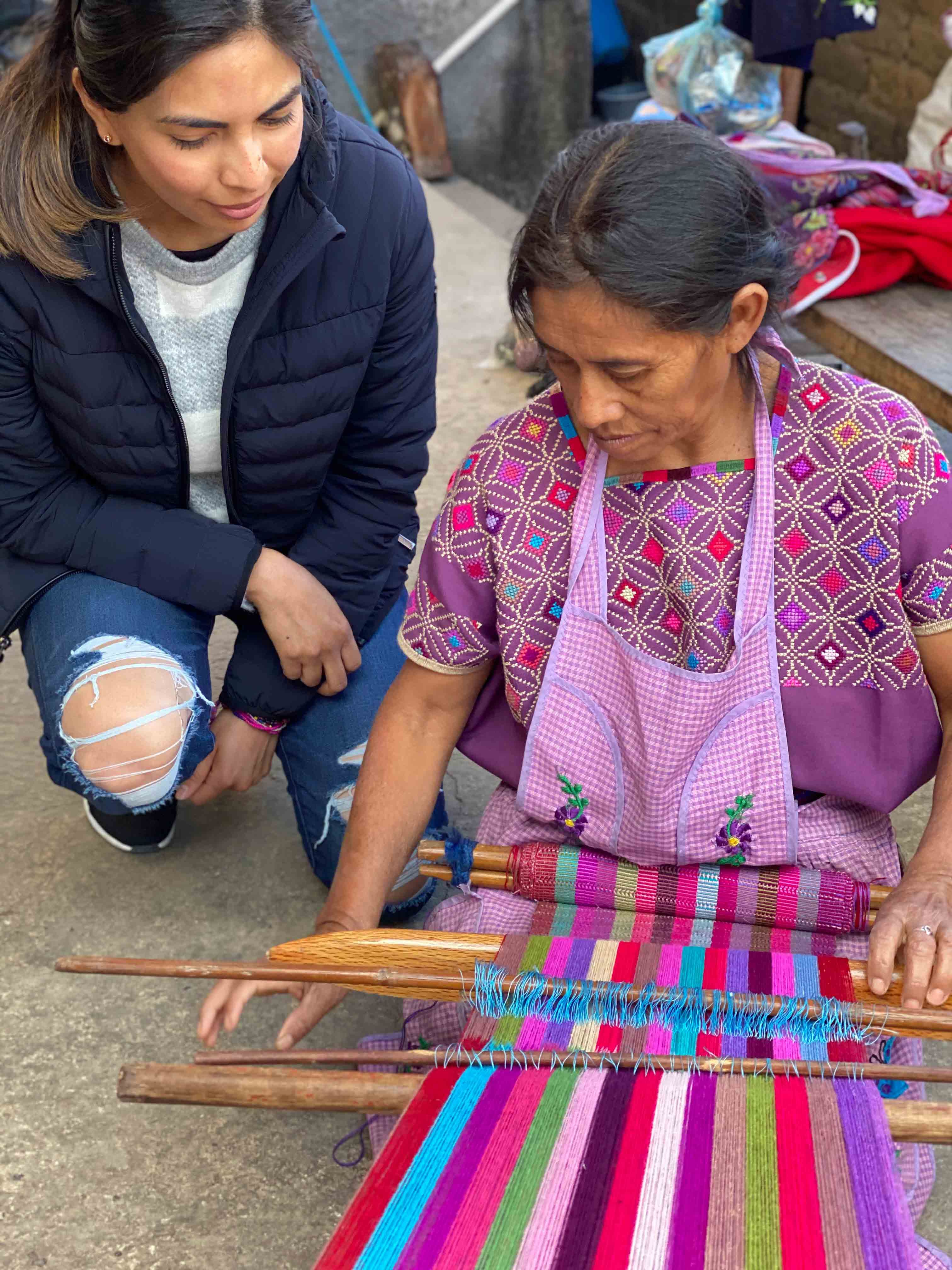 Jessica, founder of Xula Handmade with Artisan Lorenza using a traditional backstrap loom