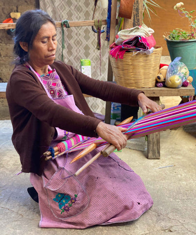 Lorenza handweaving a Xula Handmade Tote bag on a loom