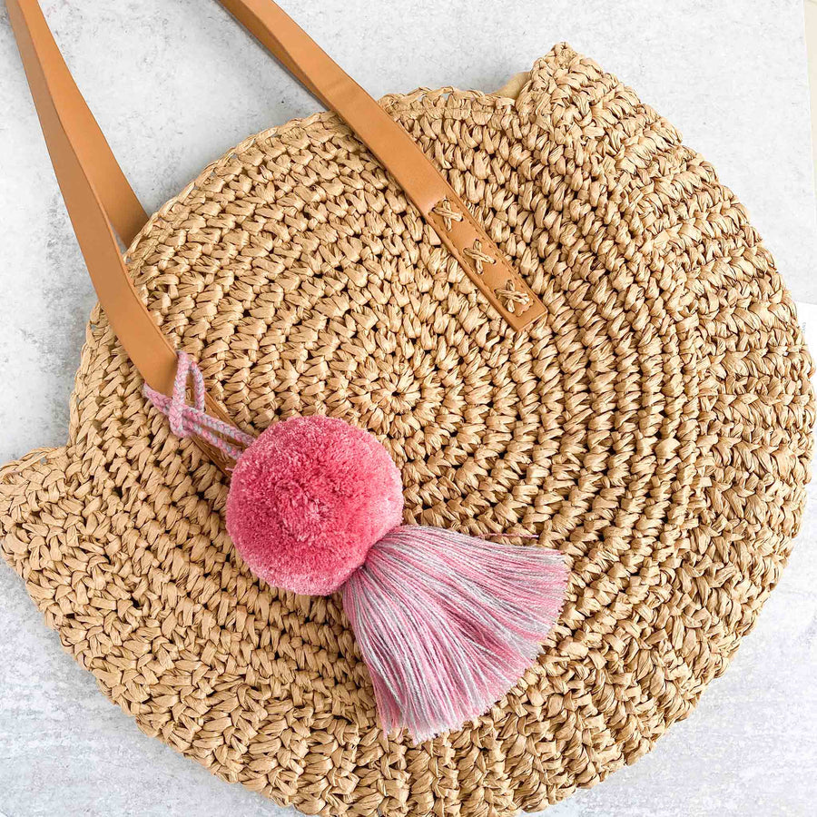 Aerial view of Straw Bag with Handmade-Large-Pom-Tassel-for-Handbag in Pink