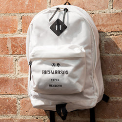 Richardson White Backpack Hanging on Brick Wall