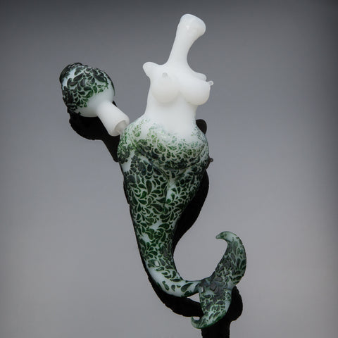 Photo of a glass mermaid pipe