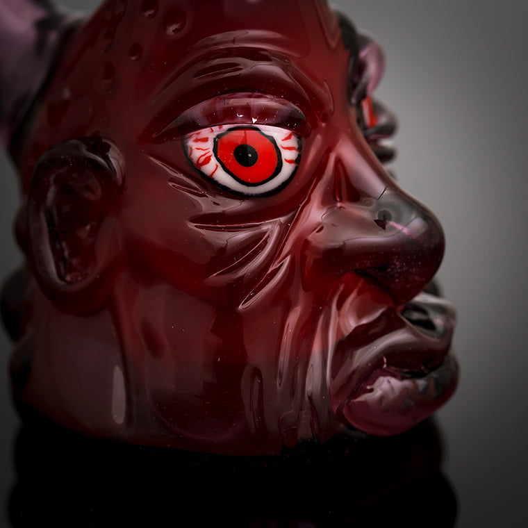 Photo of a Glass Sculpted Face w/ Bloodshot Eyes