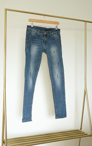 JEANS - low rise denim jeans with ripped details - M