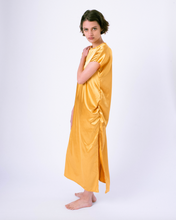Load image into Gallery viewer, gold colored satin maxi tshirt dress with side slit on woman