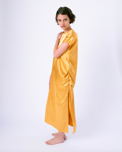 gold colored satin maxi tshirt dress with side slit on woman