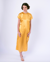 Load image into Gallery viewer, front gold colored satin maxi tshirt dress with side slit on woman