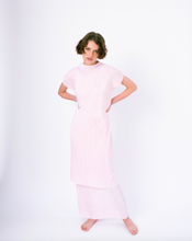 Load image into Gallery viewer, Front of pink pleated tiered maxi dress with mock neck and short sleeves on woman