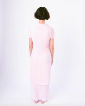 Load image into Gallery viewer, Back of pink pleated tiered maxi dress with mock neck and short sleeves on woman