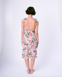Back view of scoop back midi dress with pockets & smocked top . Ruffles on straps and skirt.