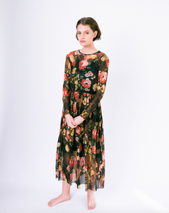 Front of floral print brown mesh overlay a-line dress with long sleeves over attached satin slip on woman