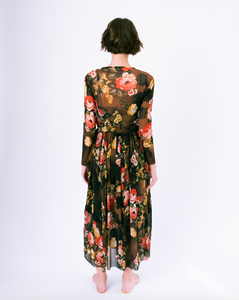 Back of floral print brown mesh overlay a-line dress with long sleeves over attached satin slip on woman
