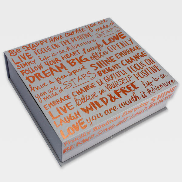 Cardboard gift box filled with inspiring words on the cover