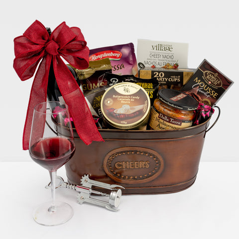 Metal gift basket from Dazzle Basket and contains wine and other gourmet snacks