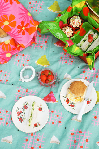 Scones-Strawberries-And-Cucumber-Sandwiches-On-A-Picnic-Blanket