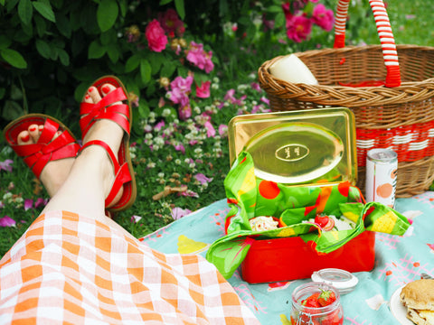 Lying-On-A-Picnic-Blanket-With-Sandwiches-And-Cakes