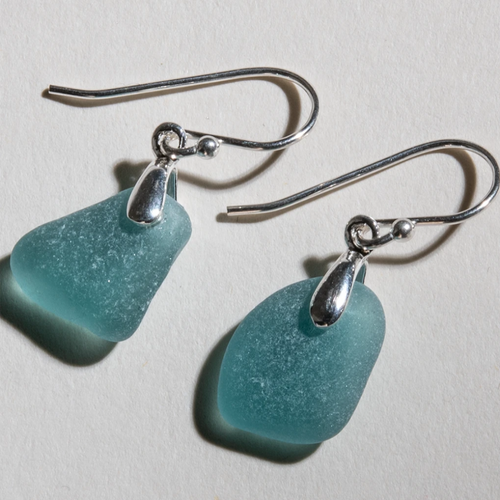 Small deep teal sea glass earrings made with sterling silver bales and ear wires