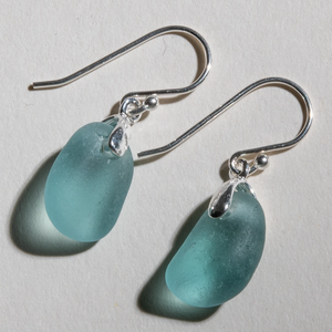 Small dangles of teal sea glass earrings made with sterling silver bales and ear wires
