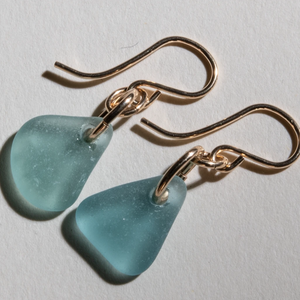 Small dangles of teal sea glass earrings made with 14 karat gold fill settings and ear wires