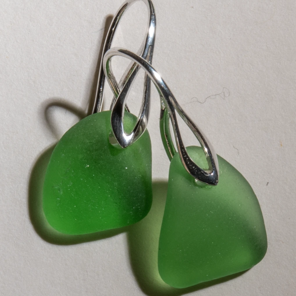 small green sea glass earrings with sterling silver art deco settings