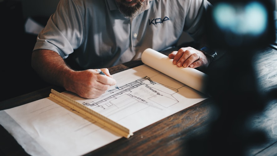 An architect carefully designs the initial concept for the project.